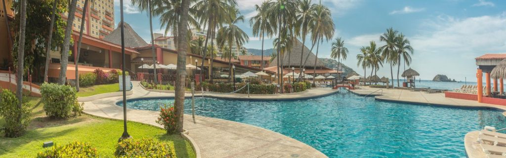 The beachside pool and plush grounds are a selling points for the IHG all-inclusive hotel in Ixtapa-Zihuatanejo.  Photo by IHG.