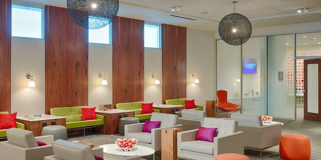 Get Airport Lounge Access with Credit Cards and have access to the new Centurion Lounge at IAH in Houston, Texas.  Photo by Amex.